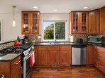 The contemporary kitchen is well-equipped and has high-end appliances