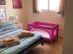 Second view of cot in the bedroom