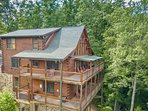Panoramic Paradise is a large 3 story cabin with 2 decks that wrap around 3 sides.