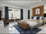Front Master Bedroom with Queen Bed and private outdoor patio