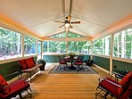 Back covered porch leads to deck with gas grill