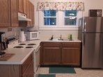 The kitchen is fully equipped.  Coffee maker, microwave oven, dishes, pots / pans, etc.