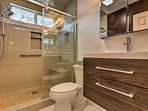 The full bathroom has a glass walk-in shower that is handicap accessible.