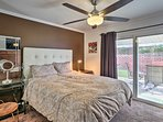 Enjoy a cool evening on the patio before retiring in this comfy king-sized bed.