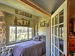 This sunroom off the master bedroom has additional sleeping.