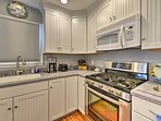The kitchen has expansive countertops and stainless steel appliances.