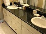 Master bath with dual vanities.