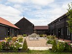 The Stables is the single-storey building on the left hand side of our rose-garden courtyard