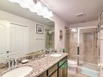 The master bathroom has his and hers sinks and a walk-in shower.