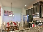 The fully equipped kitchen has granite countertops.