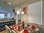 An adorably decorated table is nestled in the corner of the kitchen.