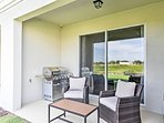 The charming patio overlooks picturesque views of the property.