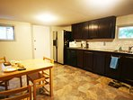 Very large kitchen is well appointed w/essentials. Walk to Wildwood Market or Amelias for groceries.