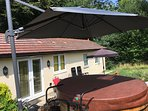 Huge Cantilever 2.7m x 2.7m umbrella for hot tub for rain or sun.