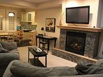 Large private living room and kitchen area, well lit, large flat screen TV with free Netflix