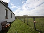 Seating at back of property for enjoying the stunning views across the sea to Cape Wrath