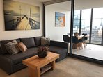 Lounge and dining area with views of the Yarra River