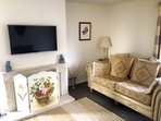 Beautiful living room. Cable TV and Netflix available.