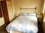 Main bedroom with a double bed, two single beds and an en-suite.