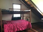 Upstairs larger room with bunks; full bed not shown