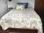 Upstairs bedroom with spring mattress and desk