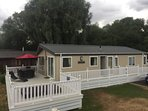 Clearwater luxury lodge with large decking area and hot tub. Sleeps 8 and also has 3 parking spaces