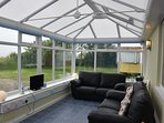 Conservatory with leather sofas for 4, TV with freeview and shoe racks.  Excellent views.