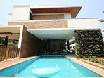 Villa view with swimming pool
