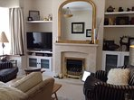 Cosy Lounge with comfortable sofa & arm chairs, TV & coal effect electric fire