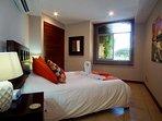 Guest bedroom with queen bed.
