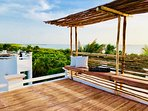 Rooftop yoga deck with 360 view of lagoon and Caribbean.