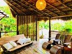Indoor/outdoor beach deck with Gabriel Peon furniture.