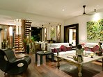 Majapahit Beach Villas - Villa Nataraja - Living and stairs to master bedroom