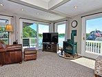 The sunny living room offers expansive river views.