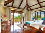Bedroom 3: Vaulted ceilings, canopy king-size bed, bay window and sea views with balcony.