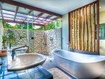 Bedroom 4: En suite, dual sink, outdoor shower and free standing bath tub.