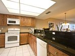 The granite countertops add great style and are easy to work on.