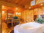 Very romantic with the floating Jacuzzi tub open to the bedroom.