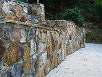 Gorgeous stone walls around the driveway.
