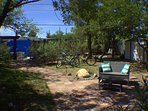 The spa/shower patio is in the far back left, the 2-person swing far back right (past shed w/bikes).