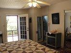 Garden door and bathroom door both open here. Mirrored sliding doors hide w/d,closet w/hangers,robes