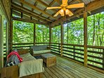 Enjoy the fresh air flowing through the screened-in porch.