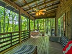 Boasting a screened-in porch, this home makes you feel like one with nature.