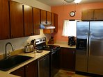 complete kitchen with fridge, filtered water and auto ice maker, DW, and full range--gourmet!