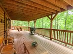 Covered Deck on Lower Level with Rustic Furnture and Porch Swing, Gas and Charcoal Grill