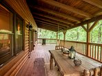 Covered Deck on Upper Level with Outdoor Dining Table and Hammock