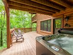 Looking over Hot Tub at Open Air portion of Lower Deck with More Deck Furniture