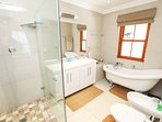 Main bathroom en-suite with walk-in shower and victorian bath and bidet