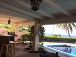 Roofed lanai with wet bar.
