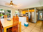 Dining and Kitchen with views if garden with path to beach. Also has a gas range.